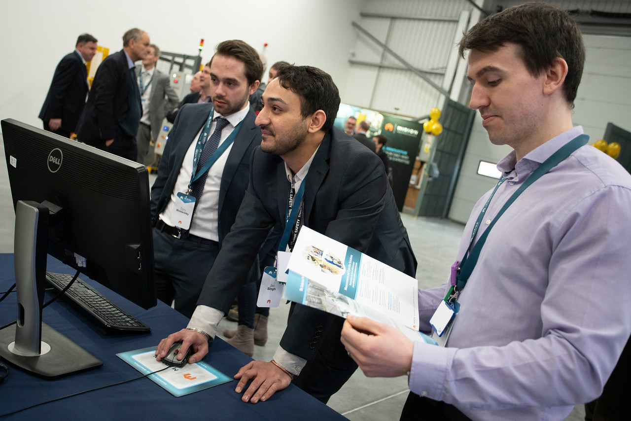 Cory Binnersley (left) and Gareth White (right), being shown our Passive and Active Neutron plus Gamma system by Jas Singh (center), during the recent opening of our new facility in Warrington.
