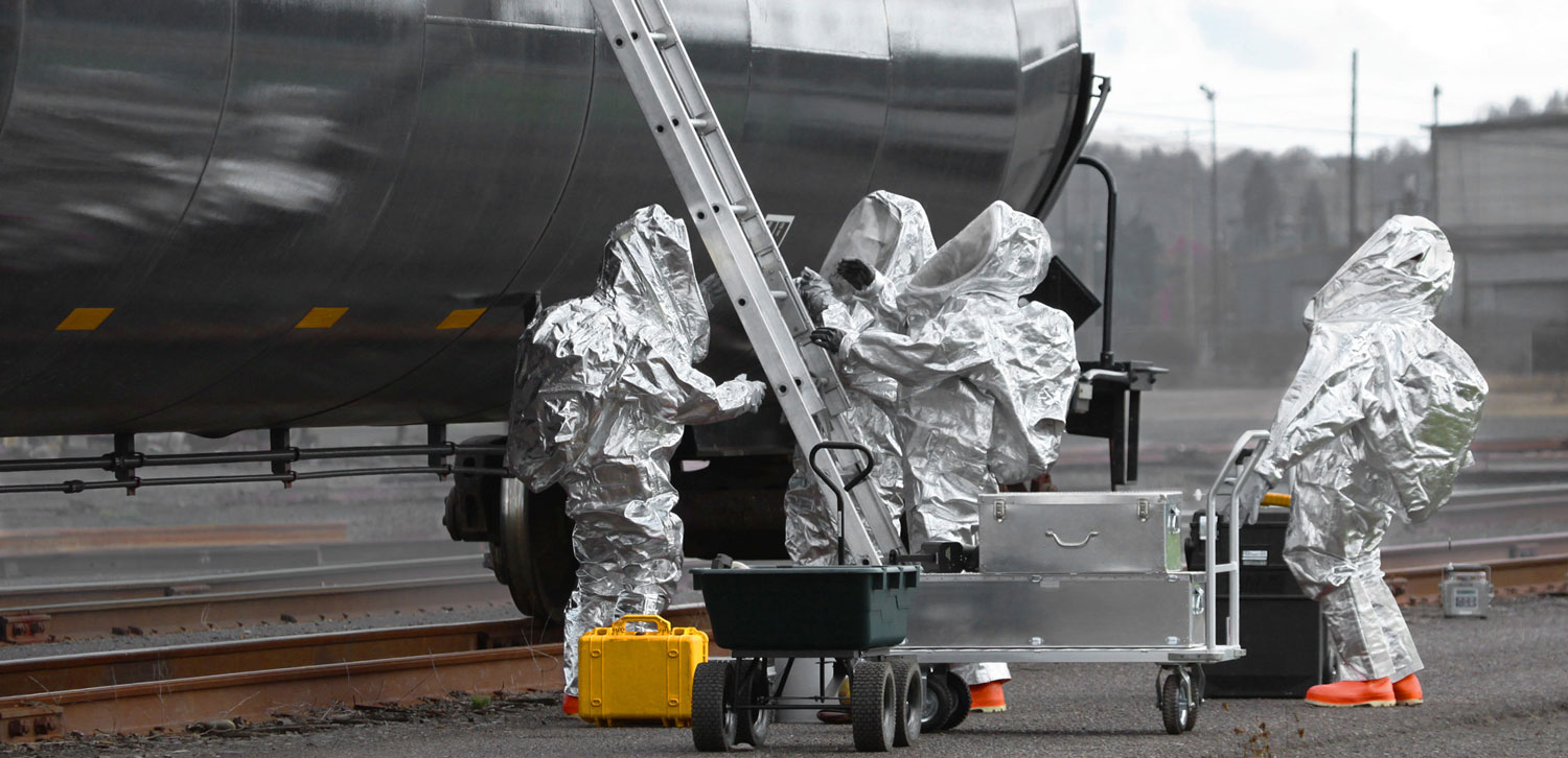 A Hazmat team performs a survey of a train car for traces of radioactive contamination